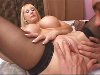 golden-haired granny with large fake tits munches