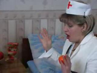 naughty golden-haired granny nurse takes a nip