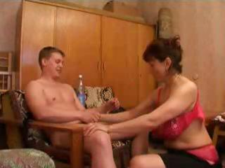 busty brunette granny receives a bunch of young