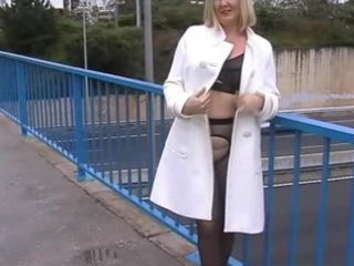 wife in dark tights hose flashing on a busy