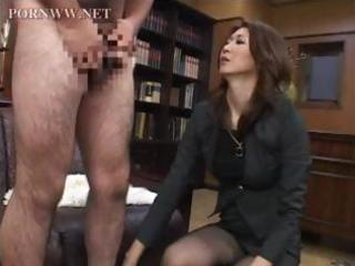 Asian mature sits on his face in the office and
