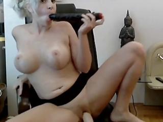 aged toying herself on web camera