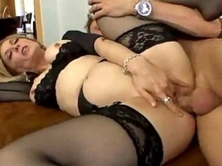 Stocking clad milf loves spreading her legs for