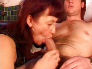 aged redhead with darksome nylons sucks cock in