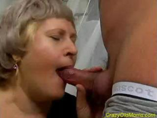 chubby granny plays the mouth organ before