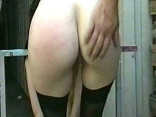 Milf slave with big tits gets naked and spanked