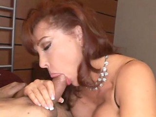 curvy redheaded mommy takes a large one in the